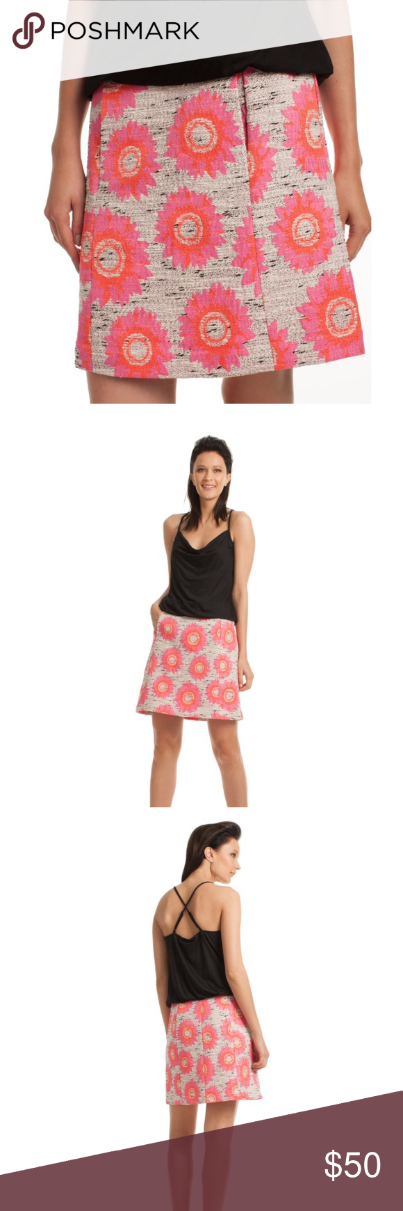 """Trina Turk Margo Textured Skirt In a chic, lightweight jacquard and a bright happy floral, the Margo Skirt makes getting dressed for pre-fall fun. With pockets and a-line silhouette, your daytime look is in stylish bloom. 19"""" Length Hidden back zipper Unlined 60% Polyester, 29% Cotton, 7% Nylon, 4% Acrylic Dry Clean. Very good condition. Have matching jacket shown in last picture. Note- skirt and jacket are slightly different in color. One is slightly lighter, hardly noticeable when wearing…"""