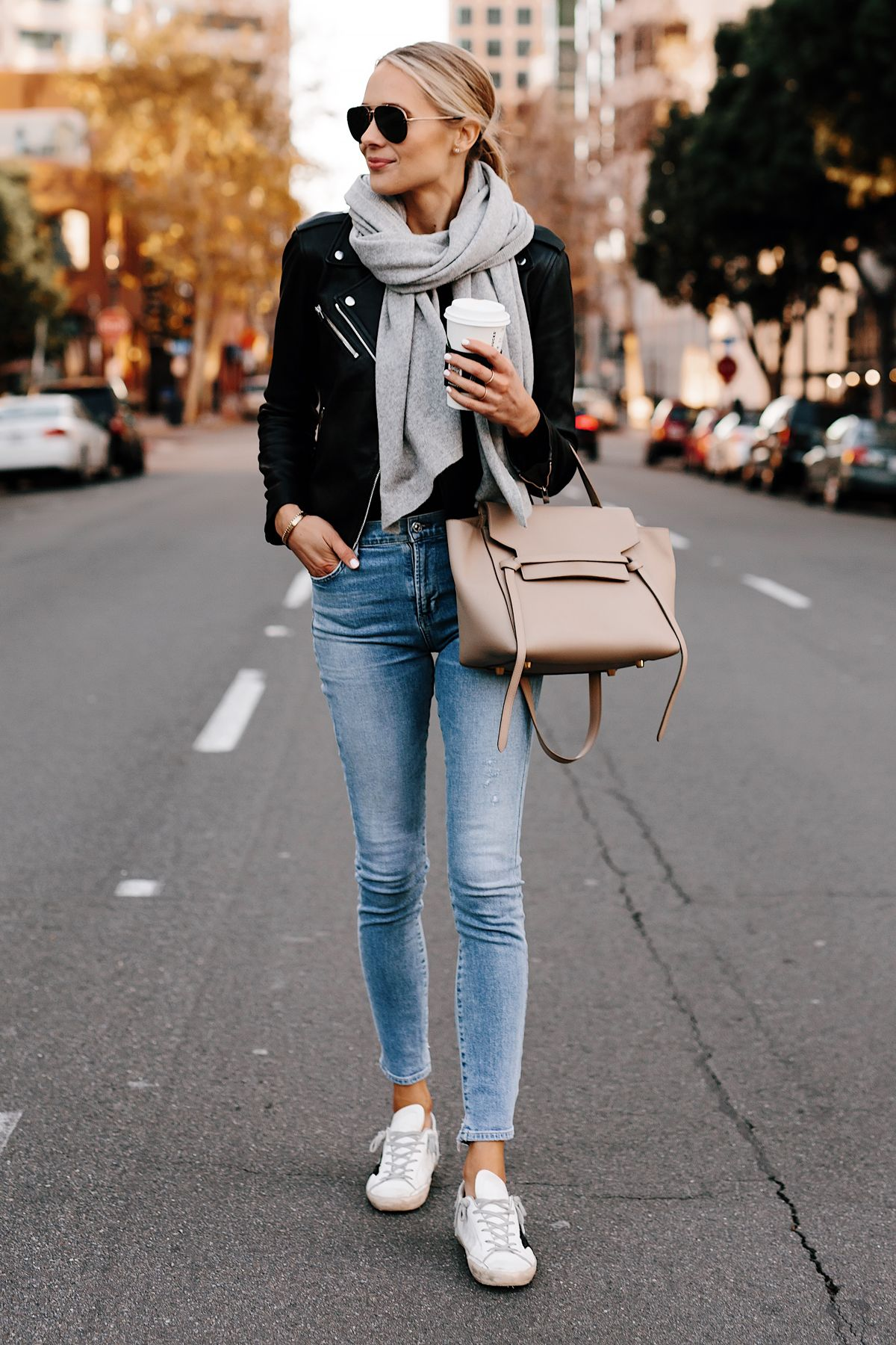 9e83fb372623a Blonde Woman Wearing Club Monaco Black Leather Jacket Grey Scarf Denim  Skinny Jeans Golden Goose Sneakers Celine Mini Belt Bag Fashion Jackson San  Diego ...