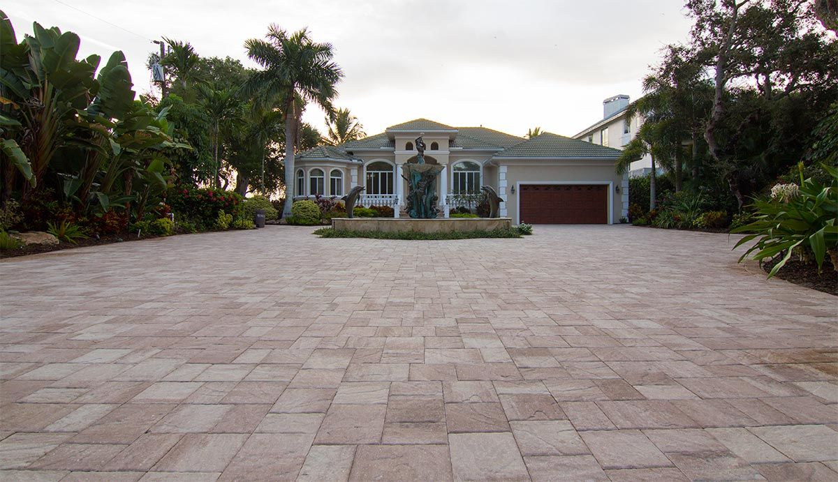 Stonehurst Sand Dune pavers from Tremron create a stunning ... on Dune Outdoor Living id=46388