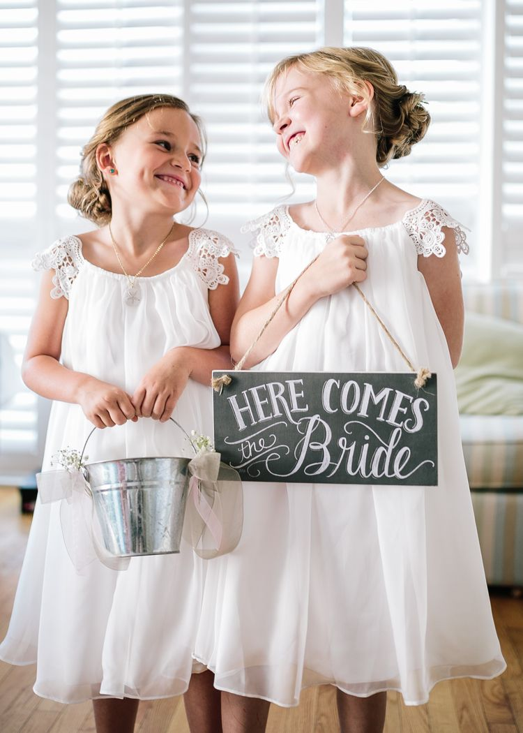 These Boho Beach Wedding Flower Dresses Are Just Too Cute I Love The Rustic Sign That They Re Holding