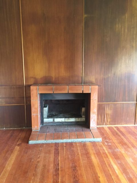 Mooiberg house - fireplace.  Living area - idea is to take off veneer wall and paint.  Remove tiles around the fireplace and re-do.