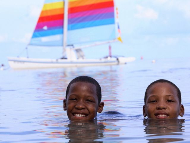 Local children playing in the warm water off the coast of San Andres, Colombia.
