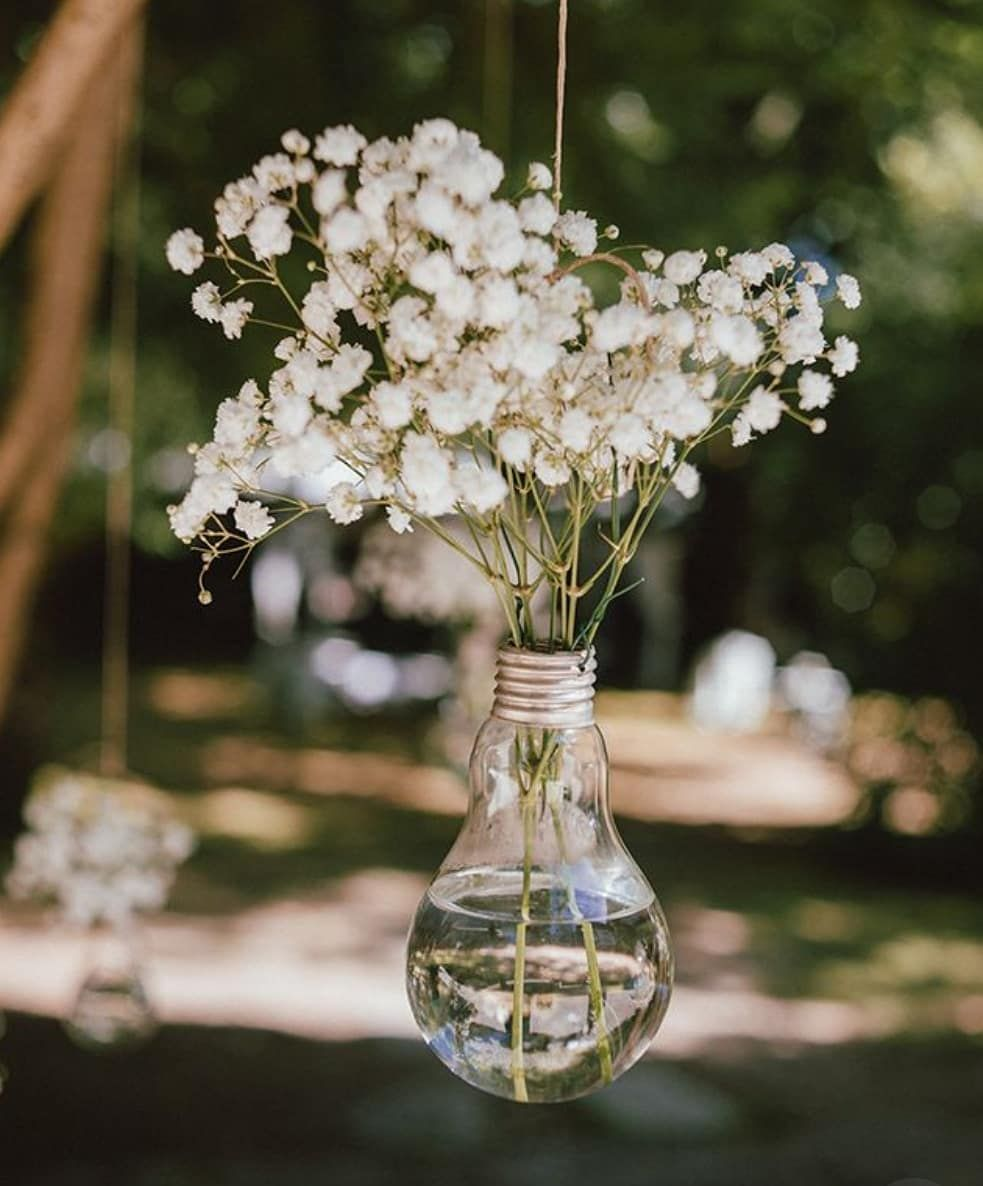 Rustic Wedding Decorations For Indoor And Outdoor Settings: Light Bulb Filled In Flowers For A Rustic Meets Romantic
