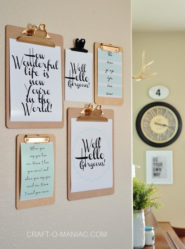 use clipboards to display printables, photos, or art prints (Craft-o-maniac)