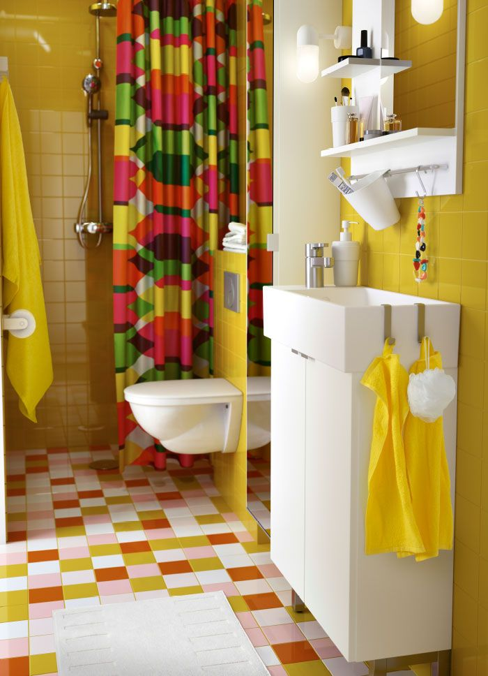 A Colorful Bathroom With A White Washstand And Mirror Yellow - Orange patterned towels for small bathroom ideas