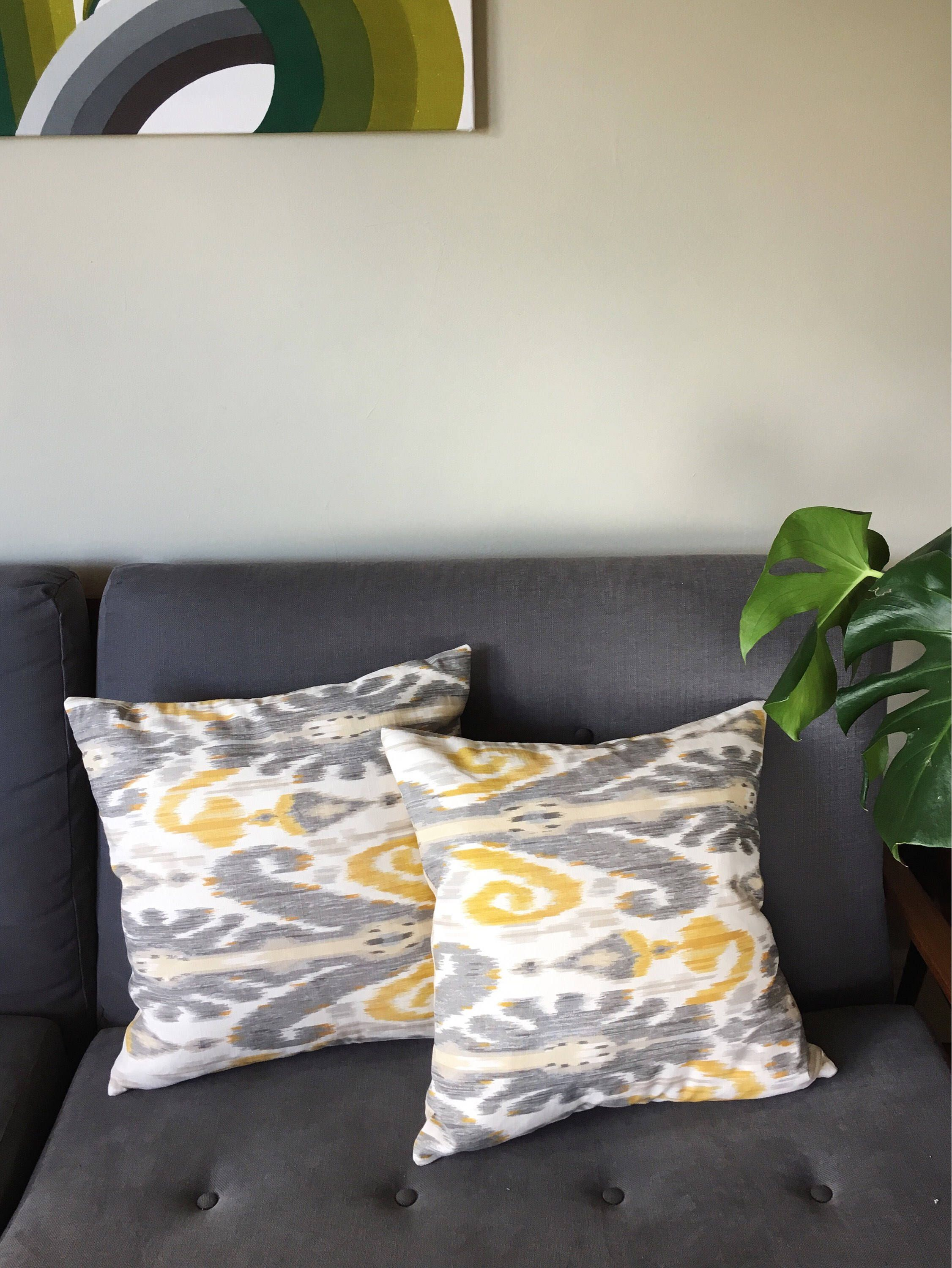 Cushion covers in lee jofaus pardah fabric in pewter yellow grey
