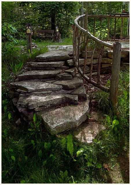 Stone steps on the hill with wood handrail outdoor for Exterior stone stairs design