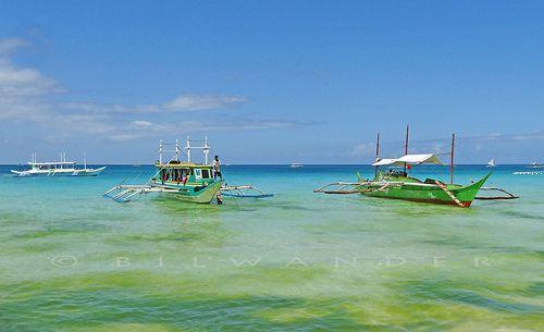 Philippines, Boracay. banghas (native outrigger canoe motor boats)