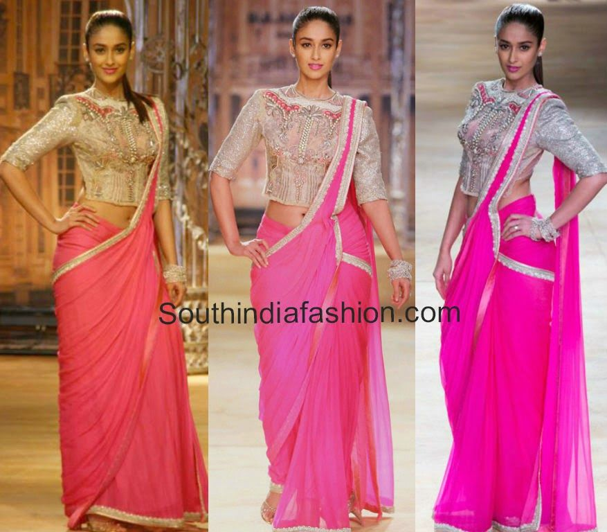 Ileana walked the ram at India Couture Week 2014 wearing a pink designer saree from Sulakshana Couture teamed up with silver high neck embellished blouse.