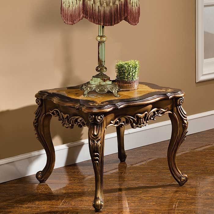 ~ Bronze and Leather ~ | Notice the lavish pierced carving on the front, and back of each piece. Tables have a unique two-toned top. | magnoliahall.com