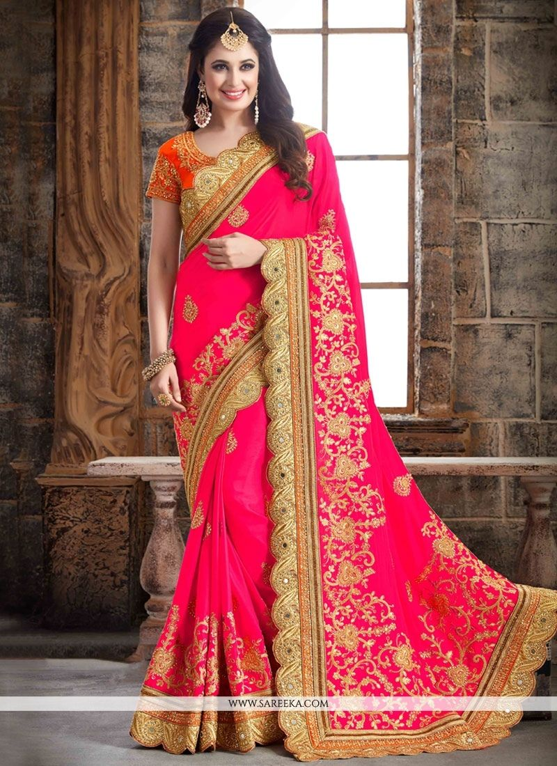 453ccb1176 Spread the aura of freshness with this hot pink crepe silk designer  traditional saree showing a touch of sensuality. The ethnic embroider.