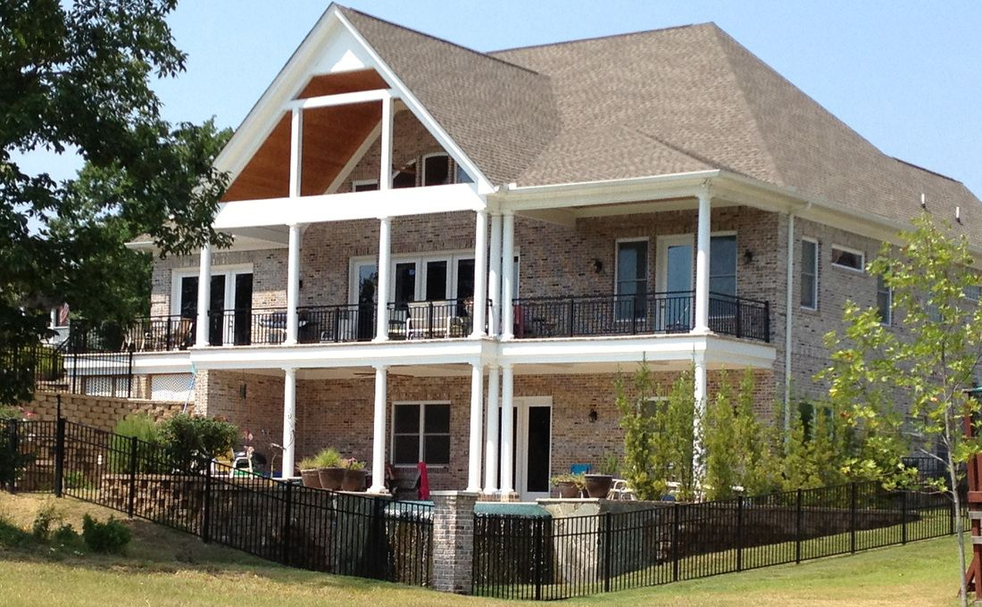 Rear view of lake house. Covered porch on second floor