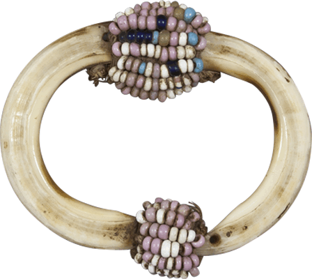 A Congo Basin Tusk Pendant with Beads