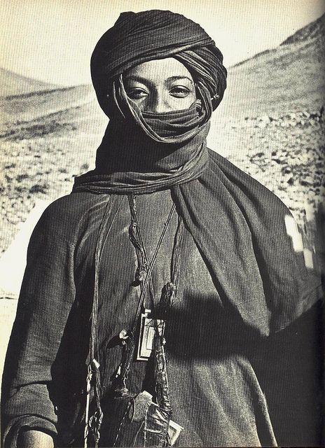 """Hiding his face, according to the custom of the Saharan Tuareg, a young man…"