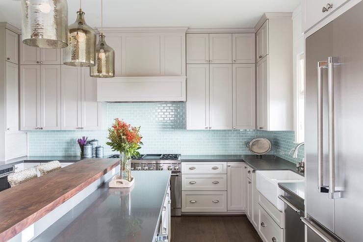 Light Gray Cabinets With Aqua Tile Backsplash And Black