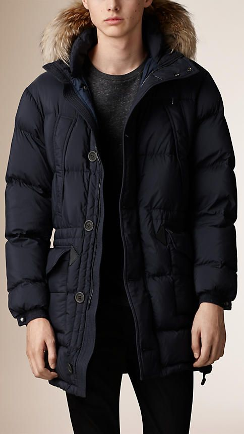 647b7f51643 Burberry down-filled parka with a removable raccoon fur trim. Woven with a  protective water-resistant finish