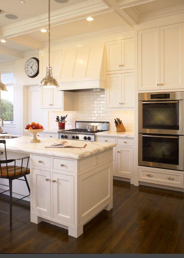 Dark wood floor, white cabinets, white subway tile backsplash and marble counters!  DREAM!!
