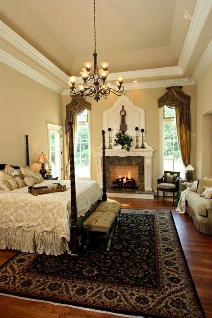 Gorgeous bedroom fireplace wood floors crown molding for Beautiful traditional bedroom ideas