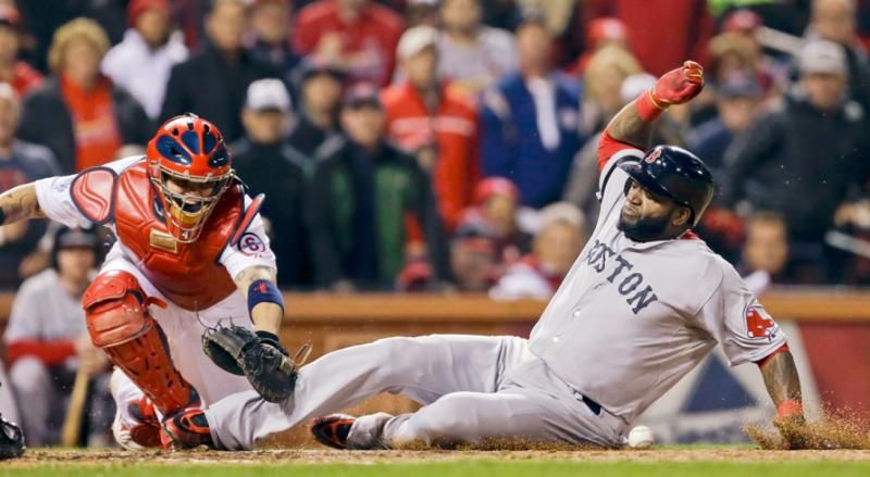 Boston Red Sox's David Ortiz slides safely past St. Louis