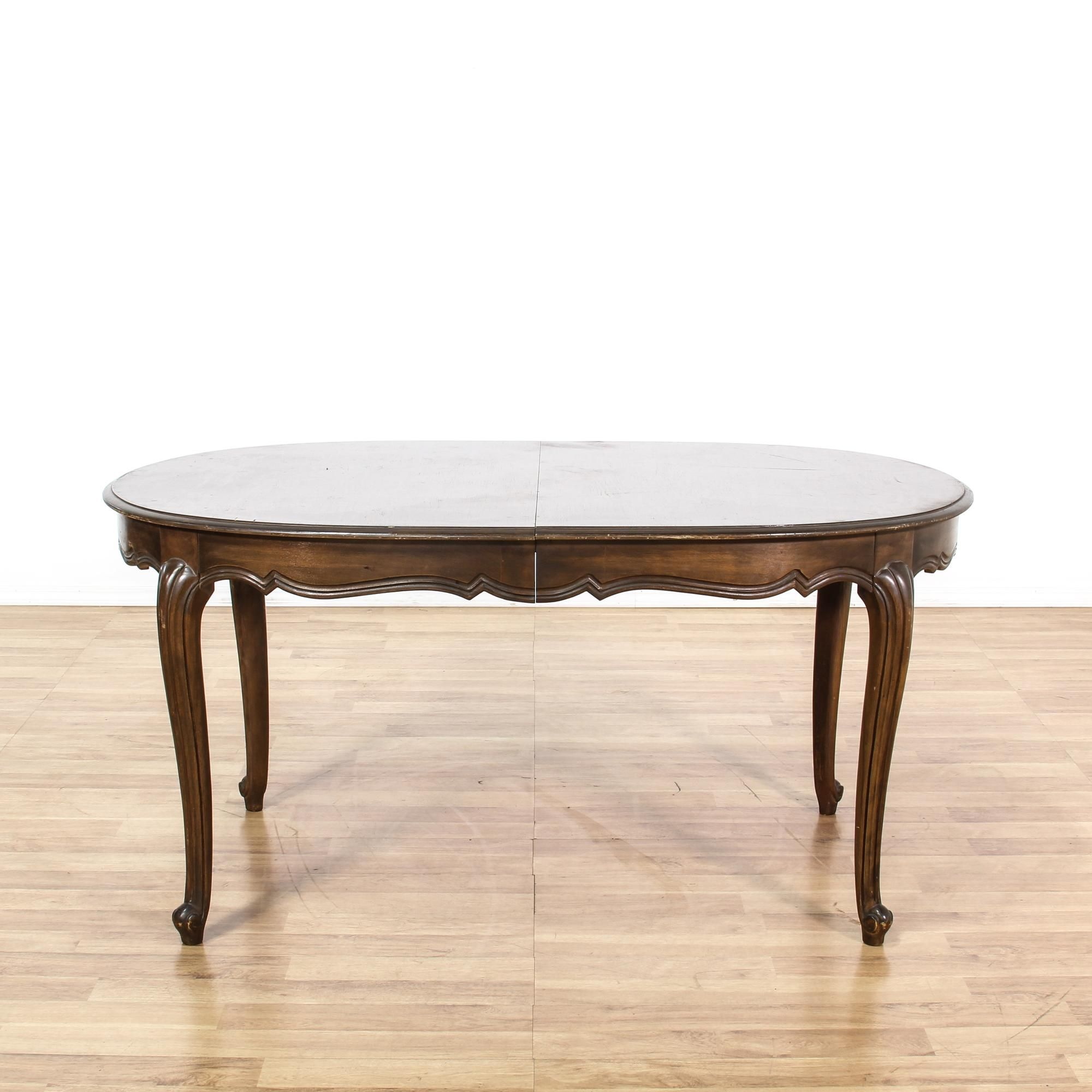This dining table is featured in a solid walnut wood with a glossy