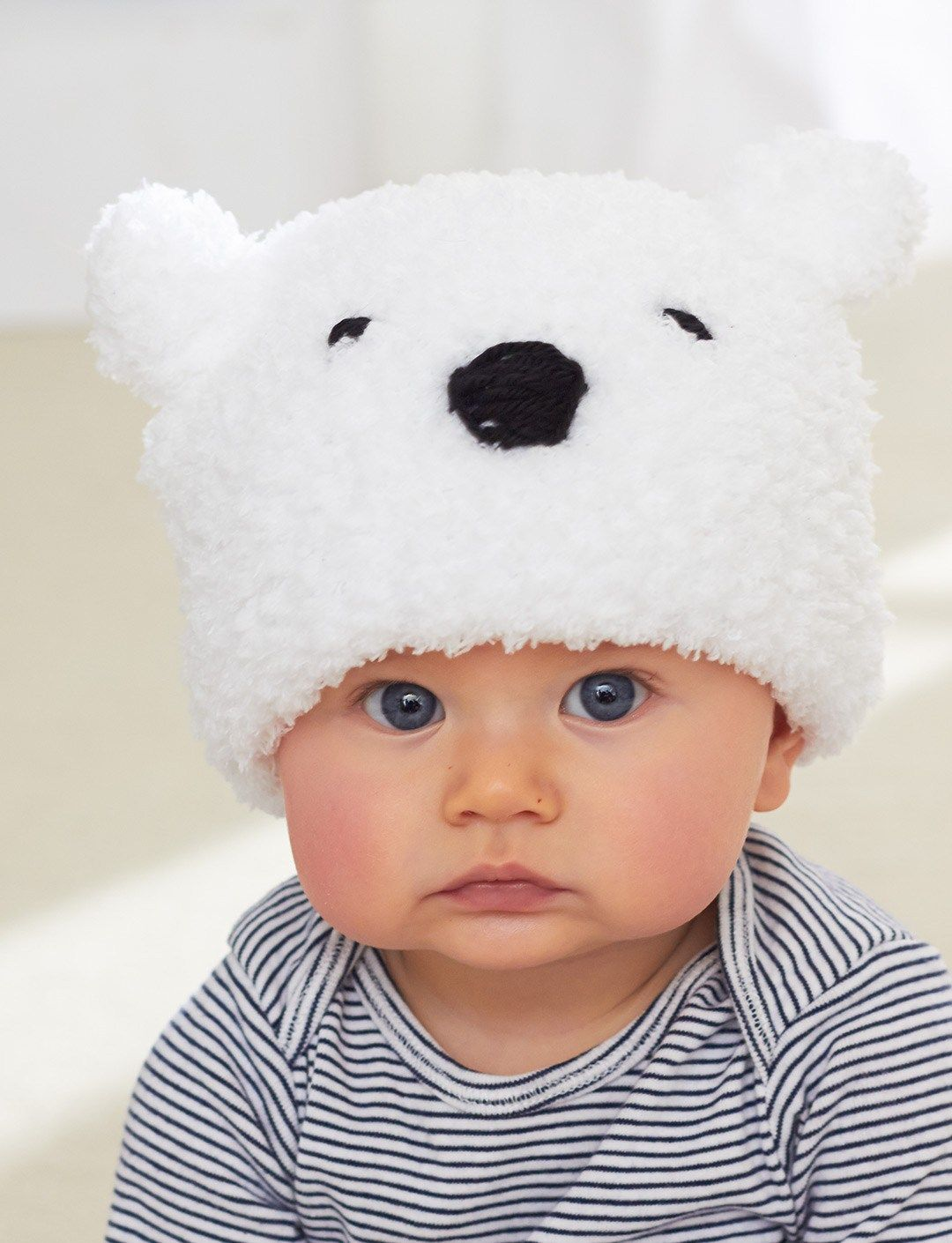 5c95758147d Free knitting pattern for Lil Polar Bear Hat - Bernat s easy baby hat is  suitable for beginners. Sized for 6 12 mos and 18 24 mos.