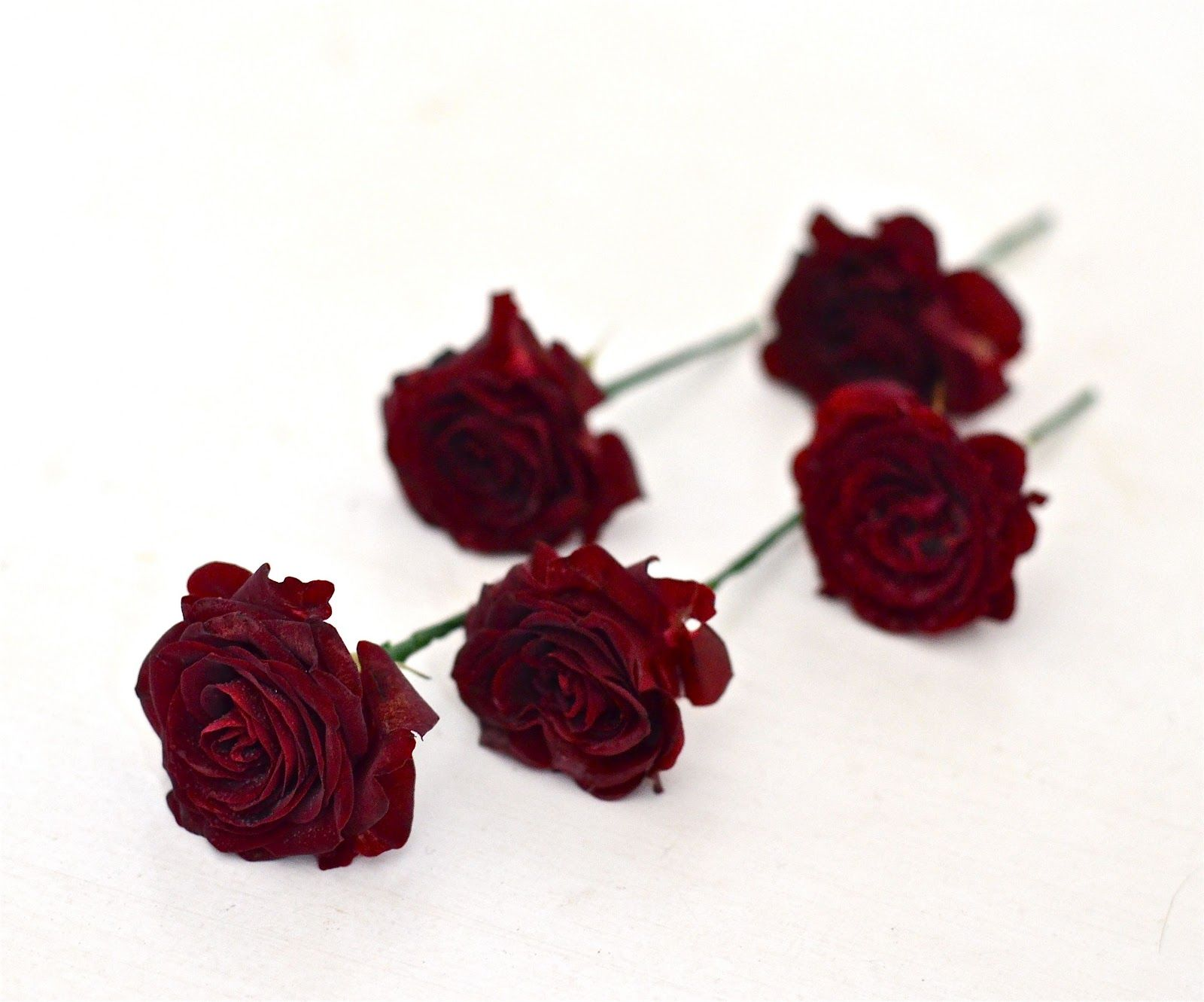 dark burgundy spray roses used in centerpieces for pops of color ...
