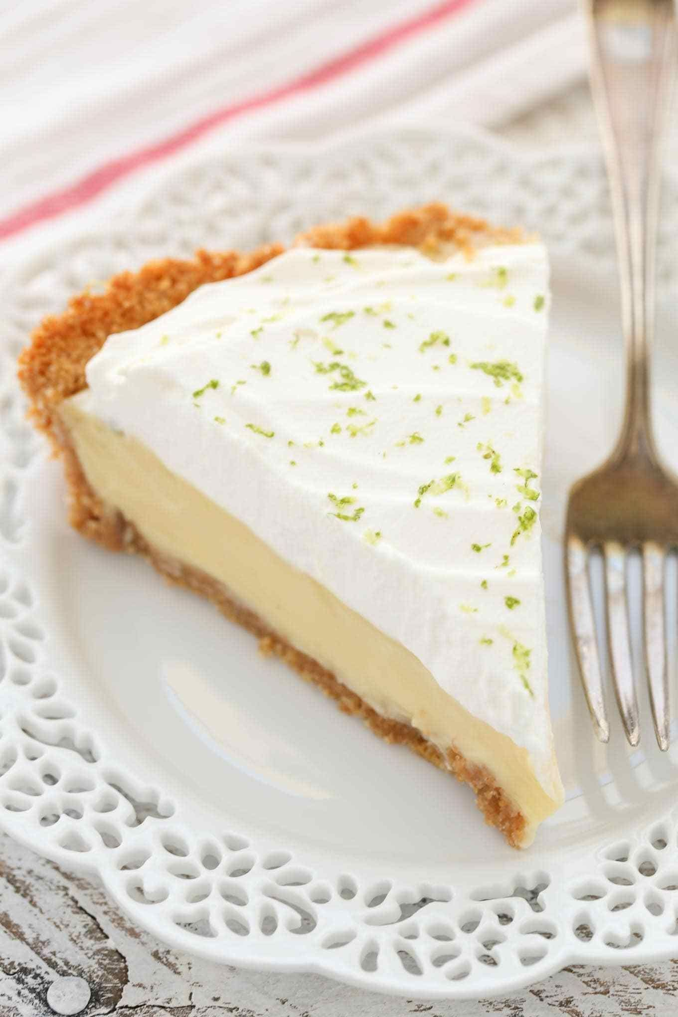 This Classic Key Lime Pie features an easy homemade graham cracker crust, a smooth and creamy key lime pie filling, and homemade whipped cream on top. The perfect dessert for key lime lovers! #homemadegrahamcrackercrust This Classic Key Lime Pie features an easy homemade graham cracker crust, a smooth and creamy key lime pie filling, and homemade whipped cream on top. The perfect dessert for key lime lovers! #homemadegrahamcrackercrust This Classic Key Lime Pie features an easy homemade graha #homemadegrahamcrackercrust