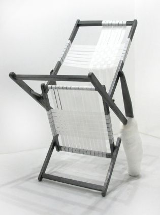 Amendment Of Unmended Mending an injured beach chair is coated in graphite pencil and woven/unwoven with medical tape in order to heal its own wounds