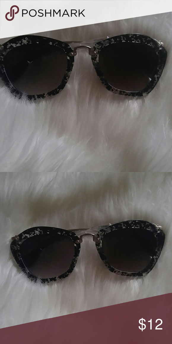 Modern speckled cat shaped sunglasses  Brand new, never worn. Will come on original packaging.Just sooo cool. Silvertone hardware and arms adds just the right pop to these cuties. Don't miss out. Very good quality. Accessories Sunglasses