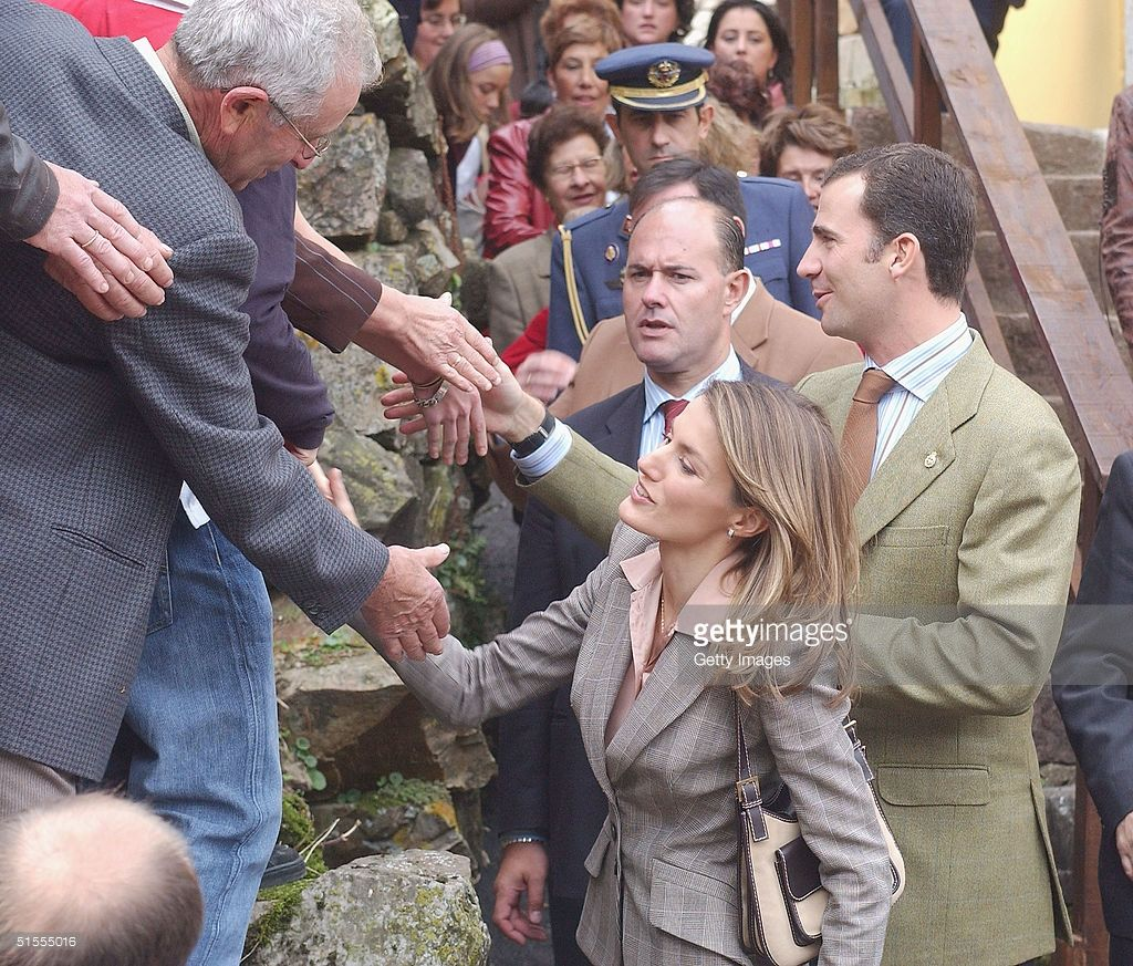 Crown Prince Felipe and Princess Letizia of Spain visit the rural village of Villar de Vildas -chosen as the Best Asturian Village- on October 23, 2004 in Asturias, Spain.The visit created much hilarity amongst villagers and locals, with them reaching out and trying to touch the visiting Royals.