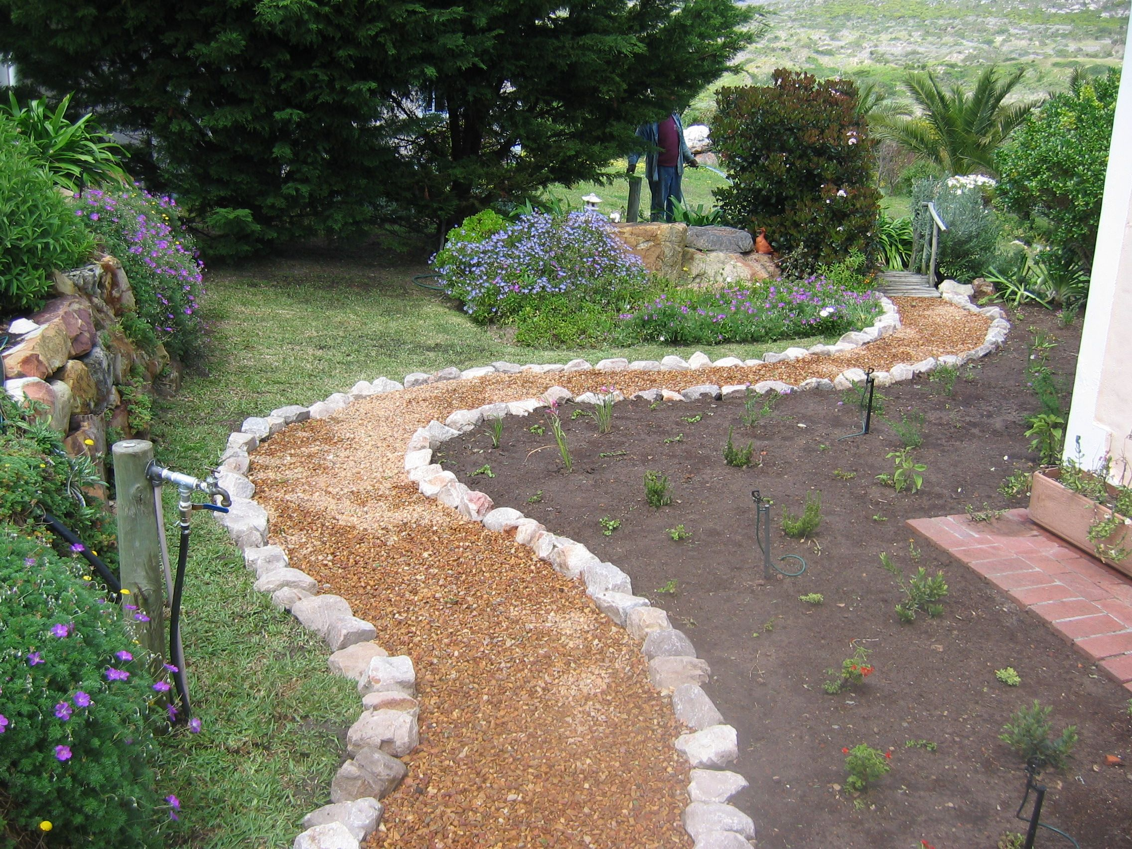 Rock Pathways Prepossessing Rock Path  Rockedged Gravel Pathway  Outsidegarden . Decorating Inspiration