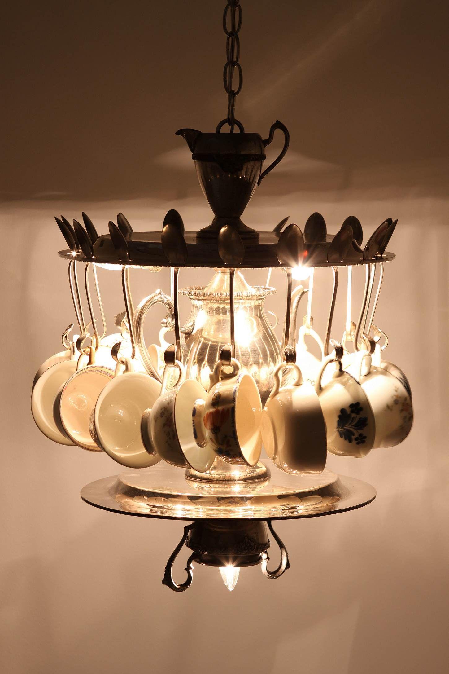 Eighteen vintage teacups dangle from an arrangement of vintage tea time chandelier arubaitofo Choice Image