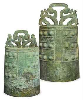 Two Chinese archaic bronze bells, zhong, Eastern Zhou dynasty (770-256 B.C.).  The larger 12½in. (31.8cm.) high over handle (2)