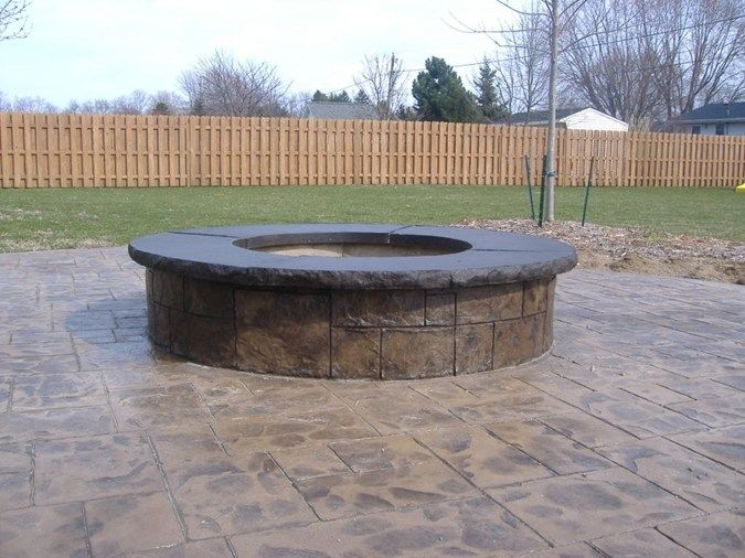 stamped concrete patio with firepit outdoor fire pits concrete impressions llc kalamazoo mi