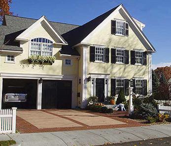 Black Shutters Black Roof Regular Red Brick Garage Door Design Black Garage Doors Yellow Houses