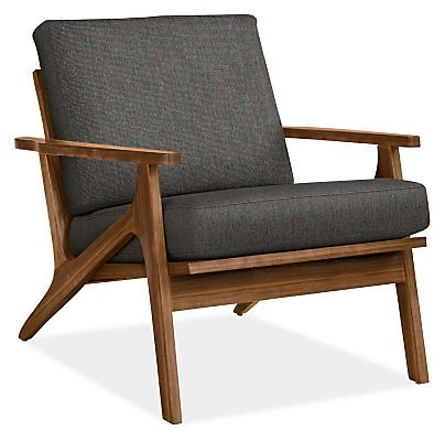 Featuring A Solid Wood Frame With Elegant Angles And A Loose Back Cushion The Sanna Chair Evokes Custom Chair Chair Design Wooden Modern Furniture Living Room