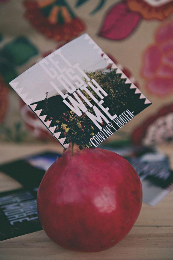 paper goods tucked into pomegranates // photo by Sassyfras Studios