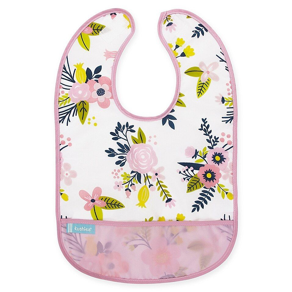 Kushies   Cleanbib Size 12-24M Waterproof Floral Bib In Pink - Keep your baby's clothes mess free during feeding time with the Cleanbib Bib from kushies. Featuring easy-to-clean waterproof material and a catch all pocket to help contain the mess, this bib is a must-have for feeding time.
