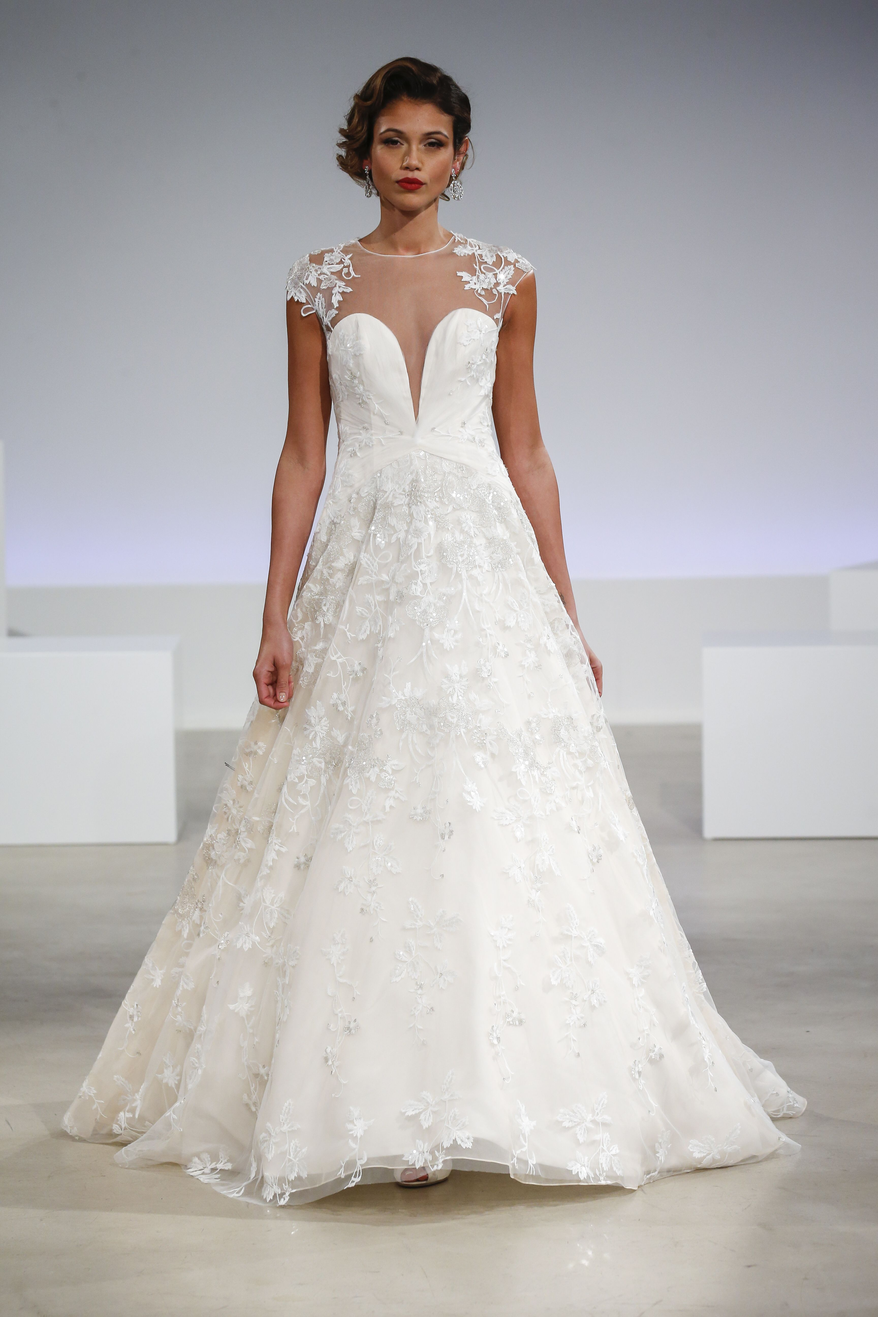 Aline Wedding Gown With A Sheer Illusion Neckline Embroidered Cap Sleeves Skirt And Plunging