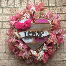 Valentines Day Wreath, Red Deco Mesh Wreath Deco Mesh Wreath, Valentine Welcome Wreath  Made with red deco mesh and ribbon. I used deco mesh to make it curly. Then added a wood sign to the center. Its guaranteed to brighten up your door. . Measures 25 Come like us on Facebook http://m.facebook.com/?_rdr#!/profile.php?id=534784239895224&__user=1573587411 Or Join this group to see my wreaths https://m.facebook.com/groups/476662562458809?ref=bookmarks