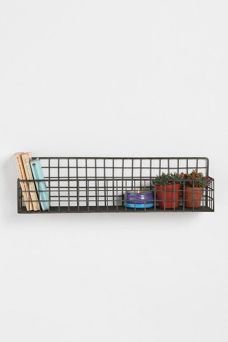 Grid wall bin ($39.00) from UO. Would be great in a vintage bathroom to hold toiletries.