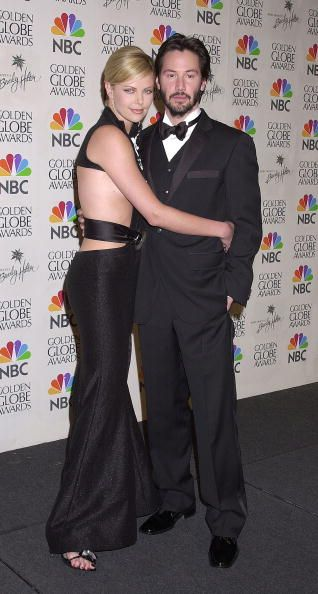 Not a Couple as in married, but a couple of friends - Charlize Theron & Keanu Reeves