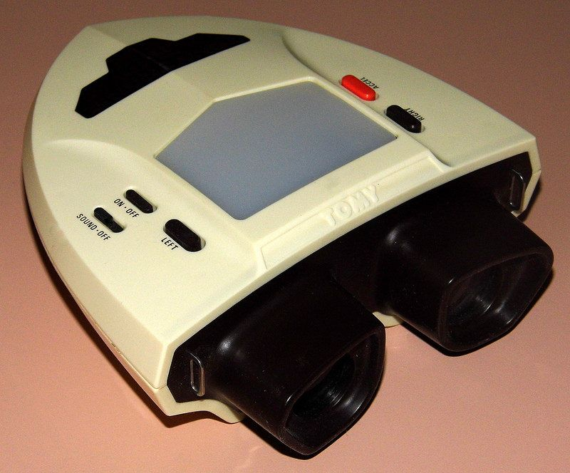 Vintage Tomytronic 3-D Thundering Turbo Electronic Handheld Game By Tomy, No. 7617, Made In Japan, Circa 1983.