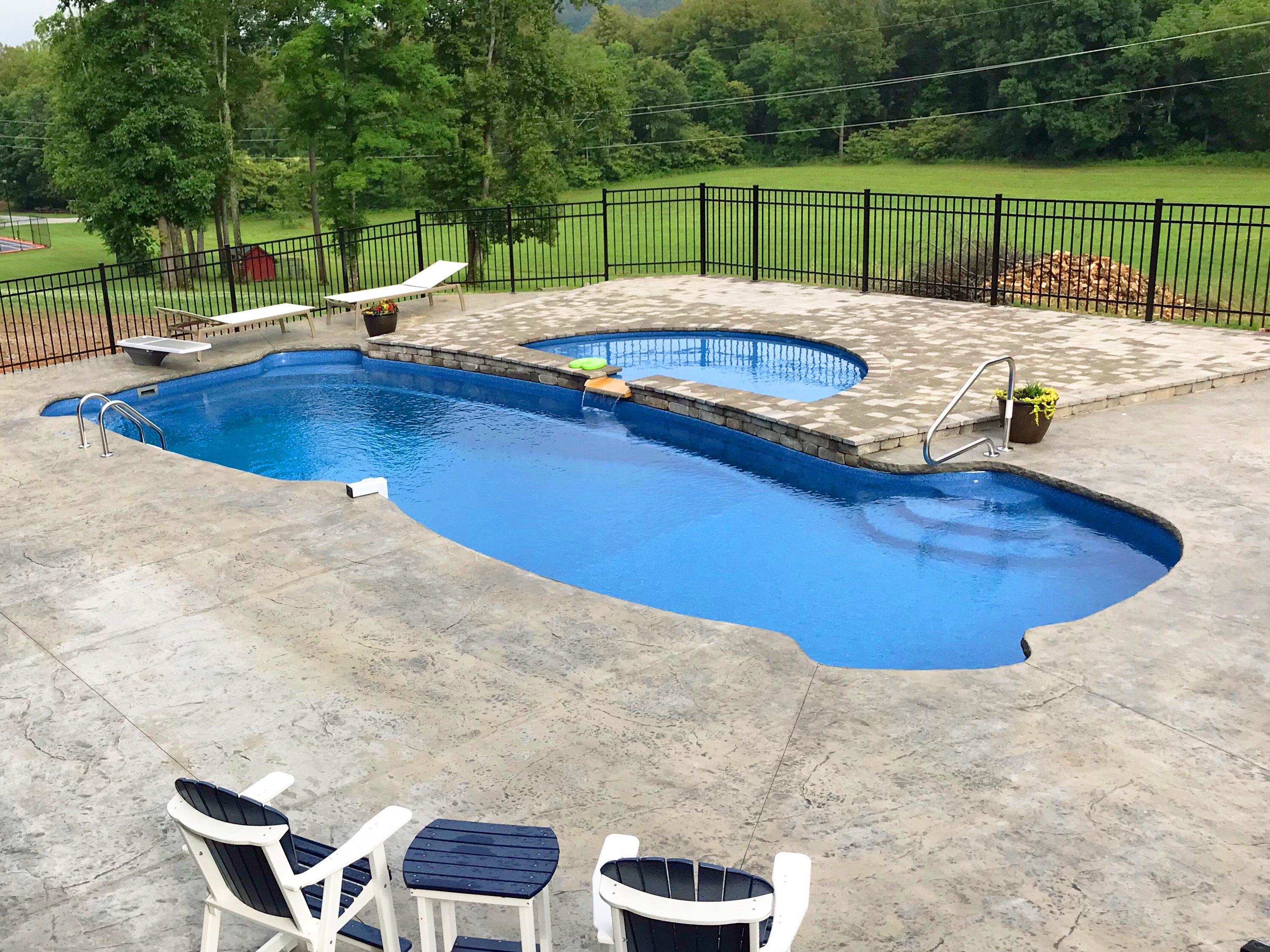 Fiberglass pool with integrated stairs and seating, and a tanning ...