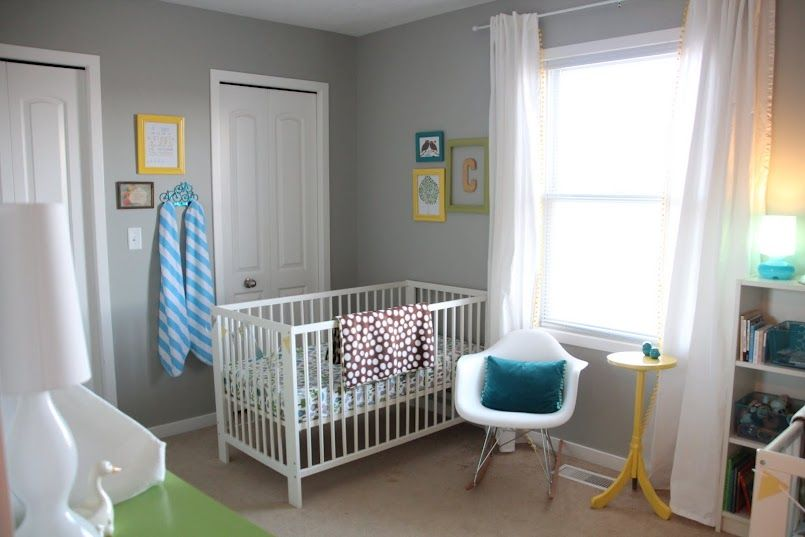 Grey Walled Nursery With Pops Of Yellow Blue And Green