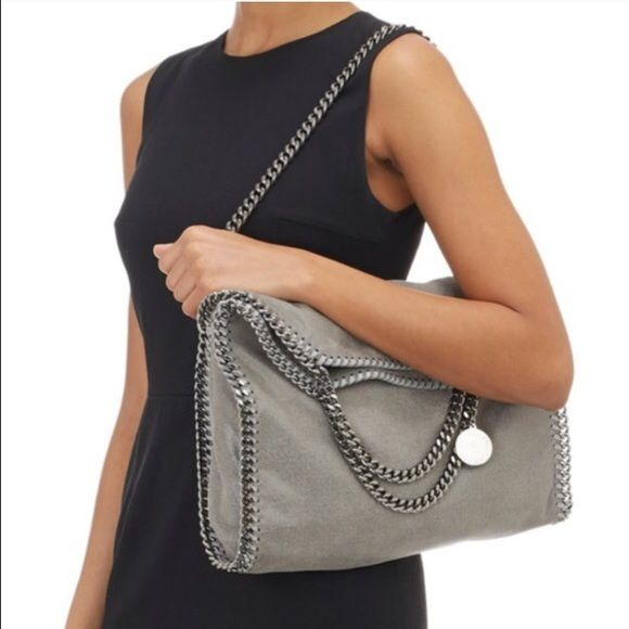 36dbf54d21a9 Stella McCartney Falabella Stella McCartney Falabella shaggy deer tote in  light grey. Ruthenium chain hardware and logo disc. An internal zipped  pocket and ...