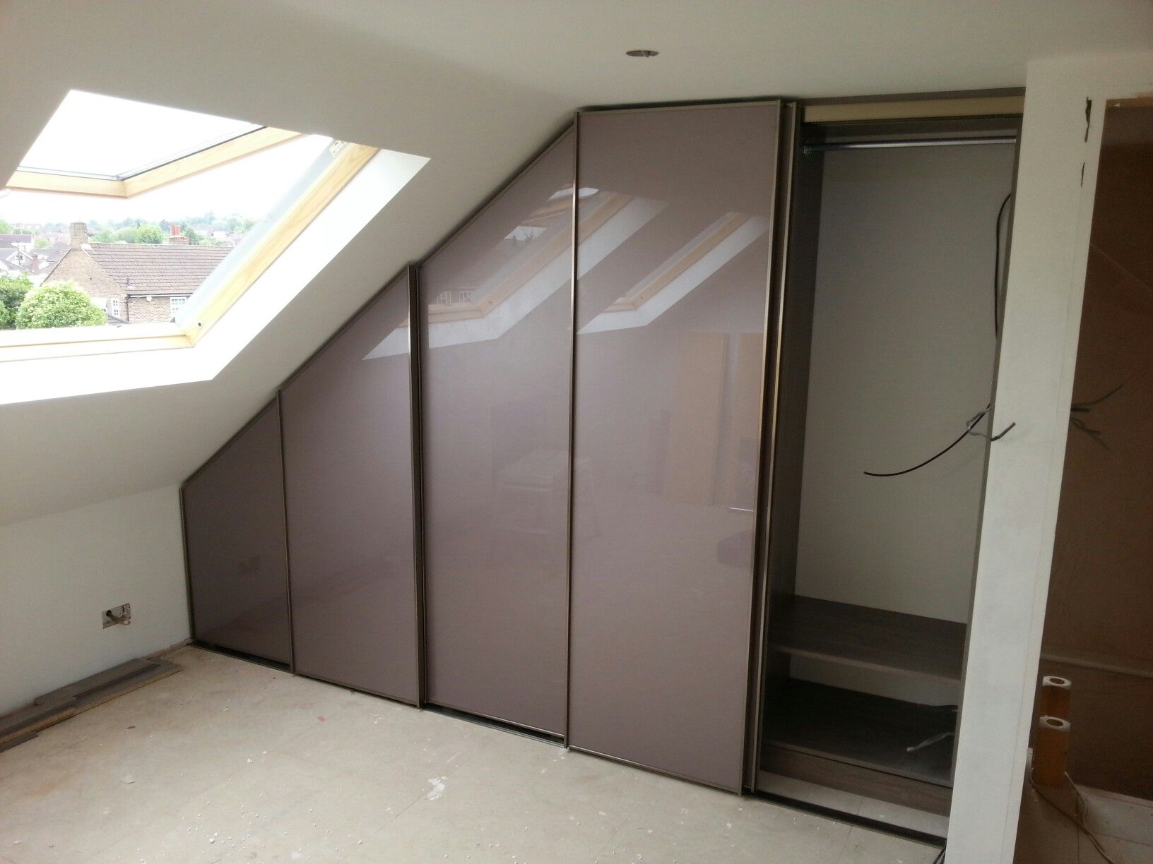 Bespoke Fitted Sloping Ceiling Wardrobe With Modern Minimalist Sliding Doors,