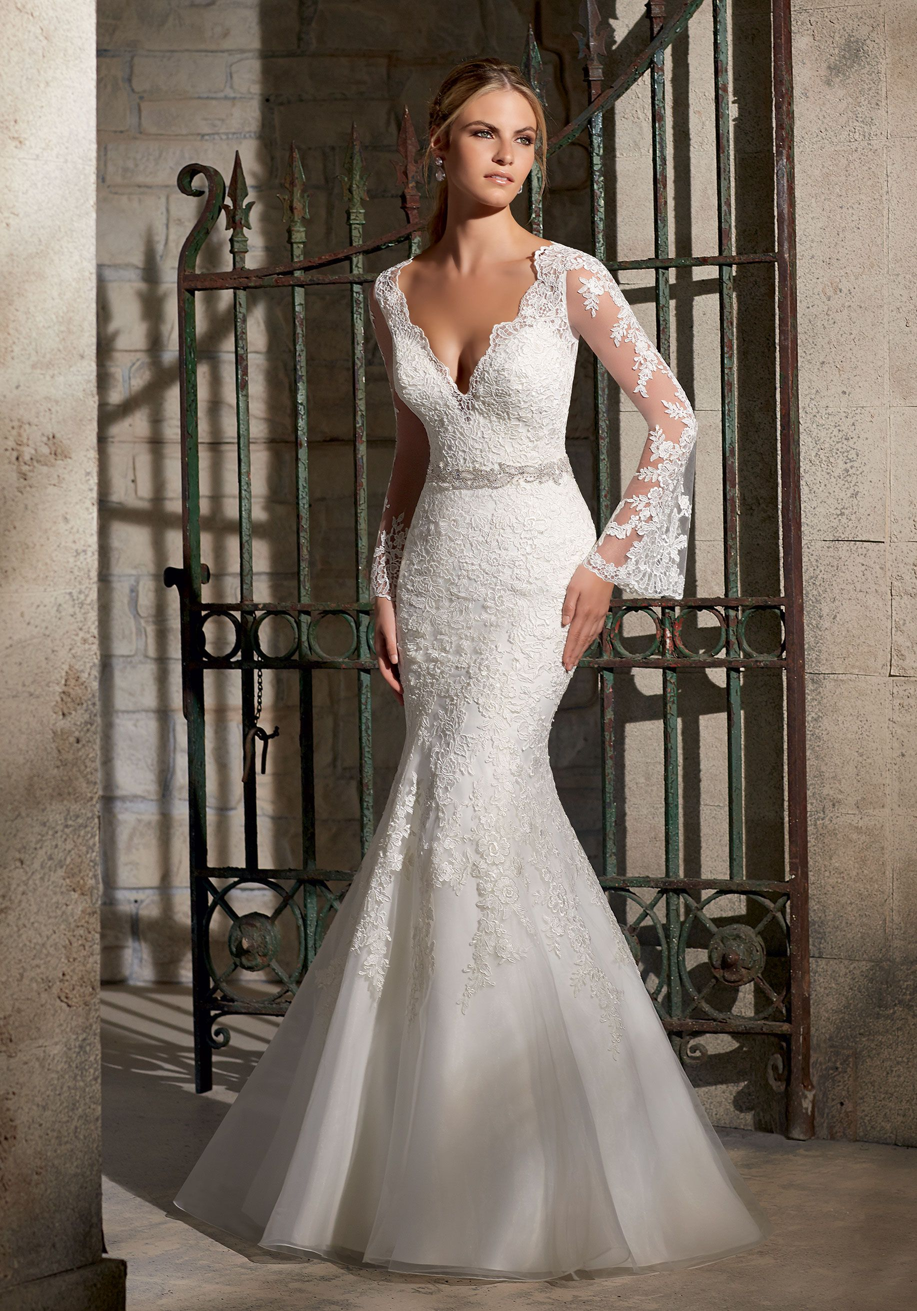 This Romantic Lace Fit And Flare Bridal Dress Features Long Bell Sleeves And Accented With Diamante Bea Mori Lee Wedding Dress Wedding Dresses Bridal Dresses