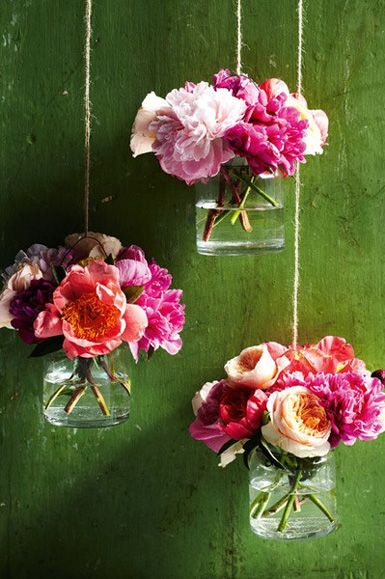 Hanging vases with colorful flowers (peonies, roses, anemones)