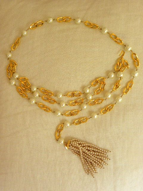 Rare vintage Chanel swagged pearl and chain belt with pearl tassel. From Season 23 (early 1980's).